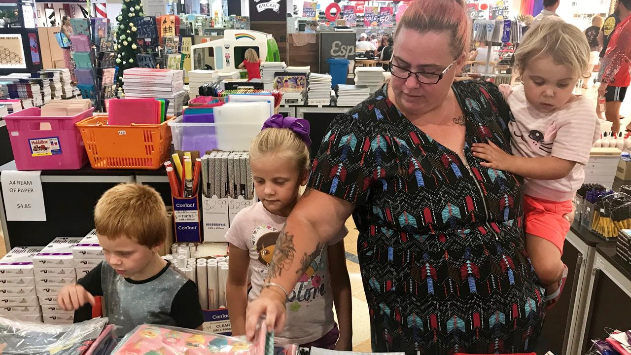 Natasha James and children Tyler, Isabella and Shelby Bruce shop for school supplies at the Back to School Outpost at Mount Pleasant Shopping Centre.