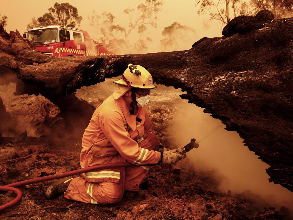 Crews put out spot fires in Sarsfield, East Gippsland. Picture: Darrian Traynor/Getty Images