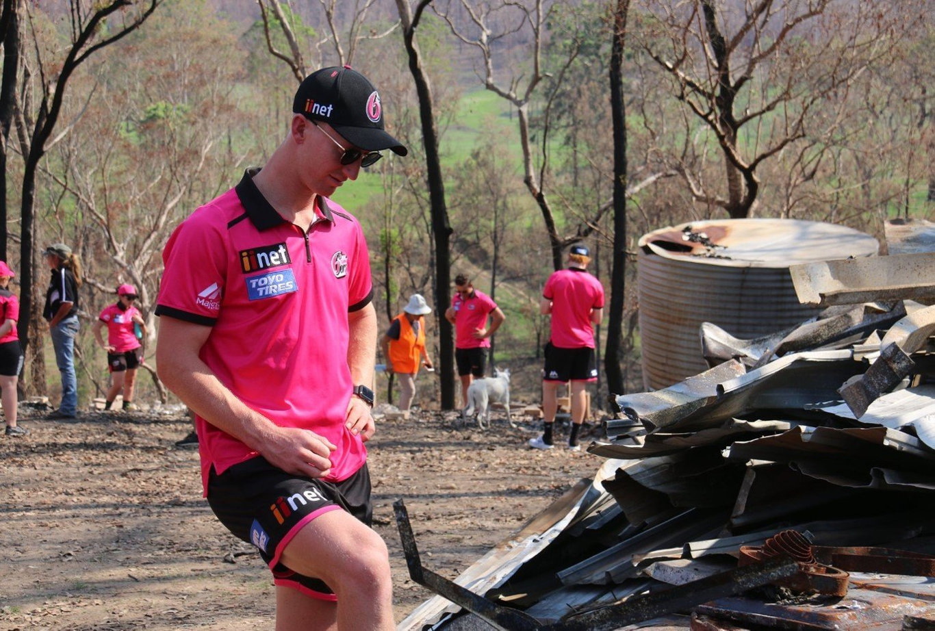 Sydney Sixers player Jordan Silk takes a moment to reflect on the tragic situation at fire ravaged Nymboida during a team visit ahead of their BBL09 fixture with Adelaide Strikers at C.ex Coffs International Stadium.
