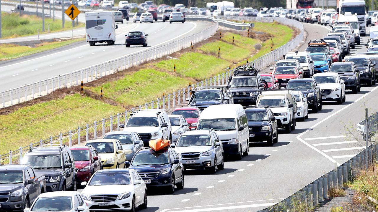 Driverless cars and smart city infrastructure should ease traffic gridlock like this seen on the Bruce Highway, but it requires significant investment to get it off the ground. Photo AAP/ Ric Frearson