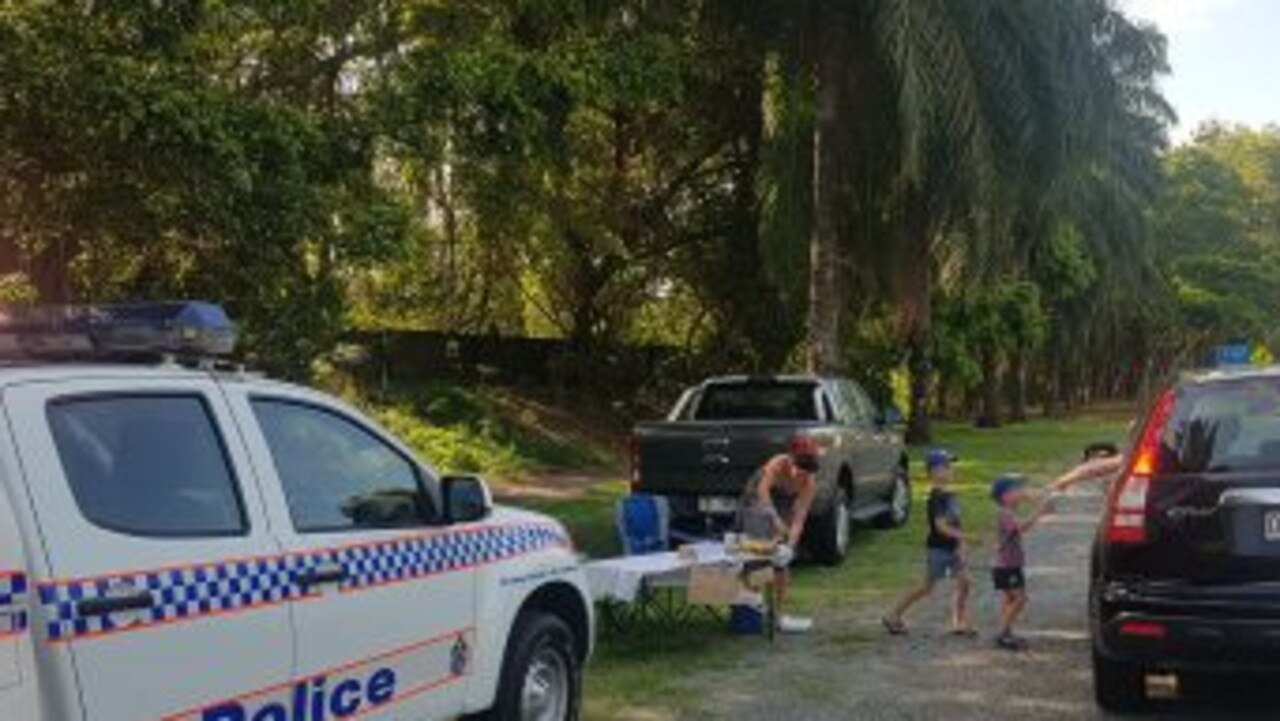 Jack and Will Reilly serving drivers lemonade on the side of Port Douglas Rd. Picture: Supplied