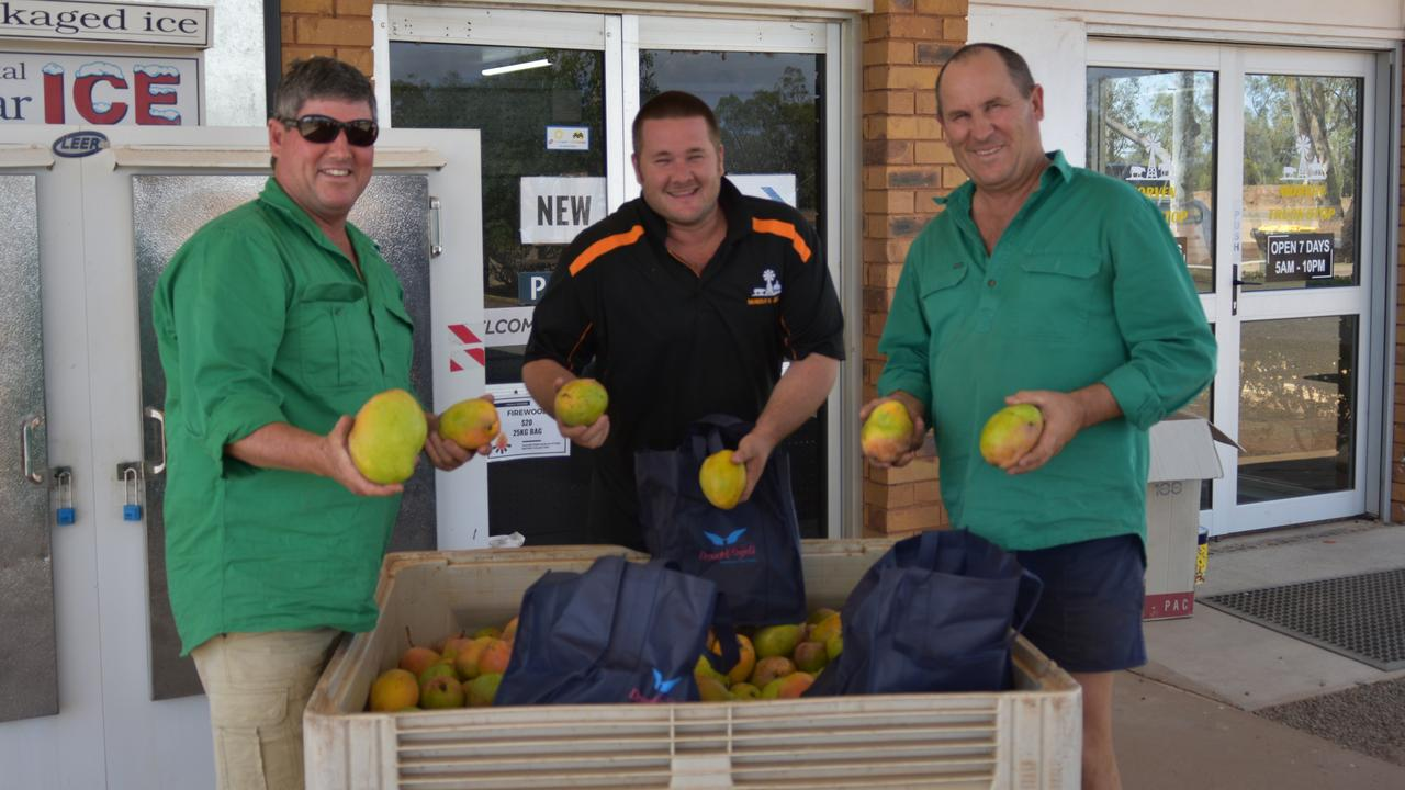 Volunteers from the Rainbow Beach Drought Runners drop off the last of their crates at Morven.