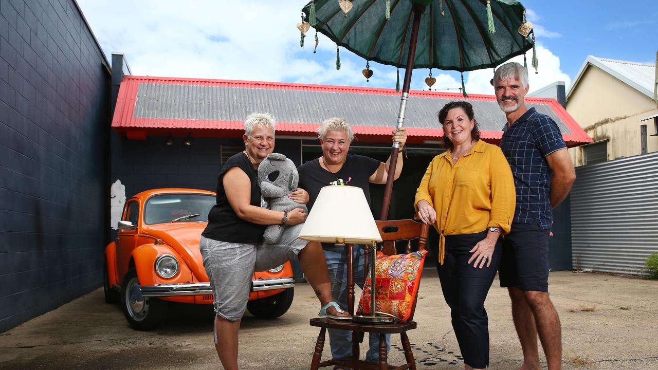Two Cairns women have decided to hold a large garage sale this Saturday to raise money to help treat animals caught in the bushfires in New South Wales and Victoria. Garage sale co ordinators Michelle Loeser and Mechel Pearson and warehouse owners Maria Messmer and Erich Messmer with some of the retro items that will be available for sale. PICTURE: BRENDAN RADKE