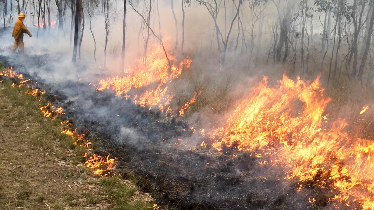 Rural Fire Brigade officers completing a hazard reduction burn south of Warwick in 2016. Picture: Queensland Fire and Rescue Service