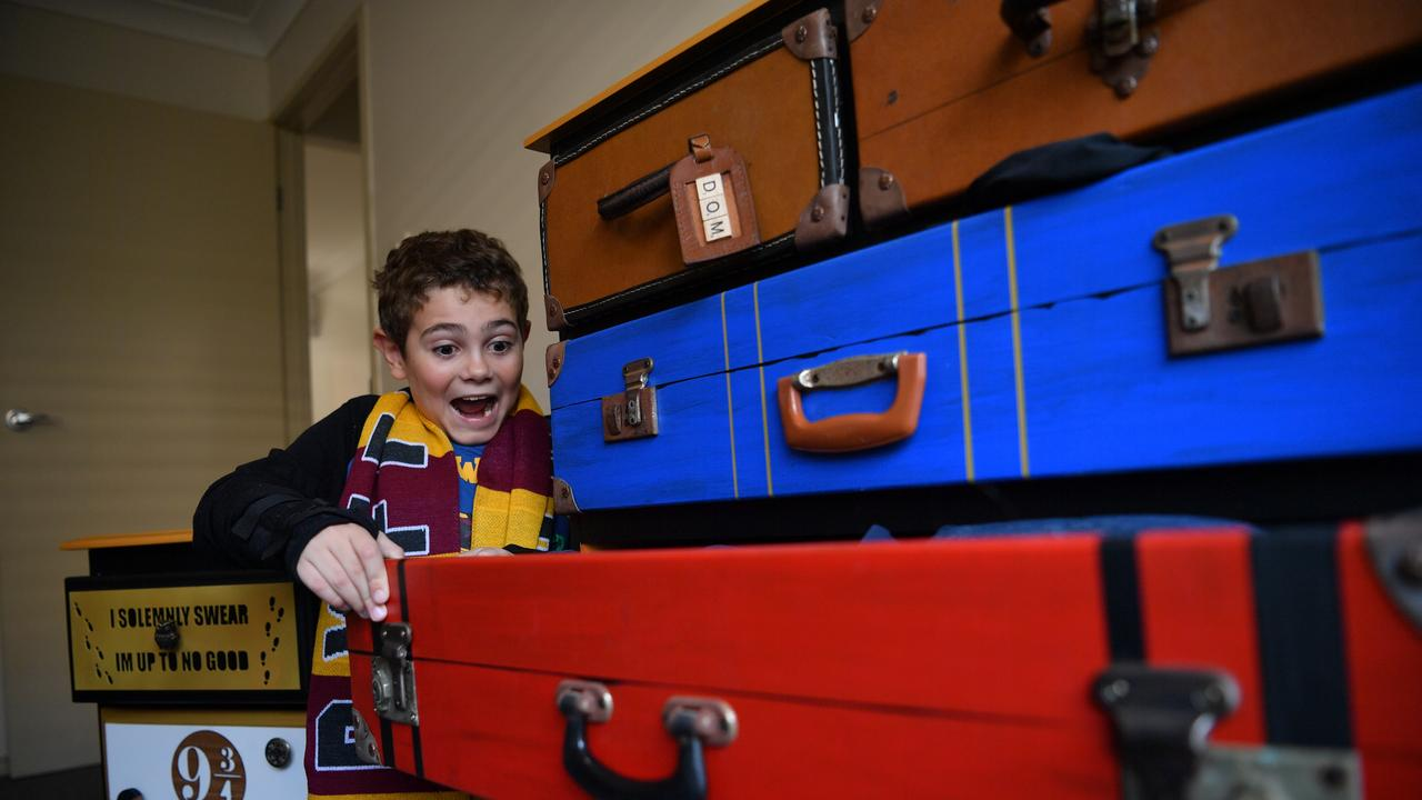 SURPRISE: Dominic Alderson, 10 was ecstatic to receive some Harry Potter themed drawers after a tough year. Picture: John McCutcheon