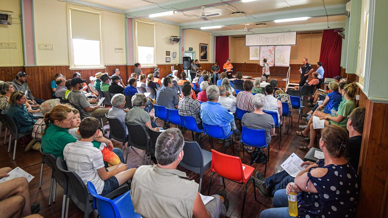 Residents at the Tallangatta Valley community meeting discuss the fire situation. Picture: Jason Edwards