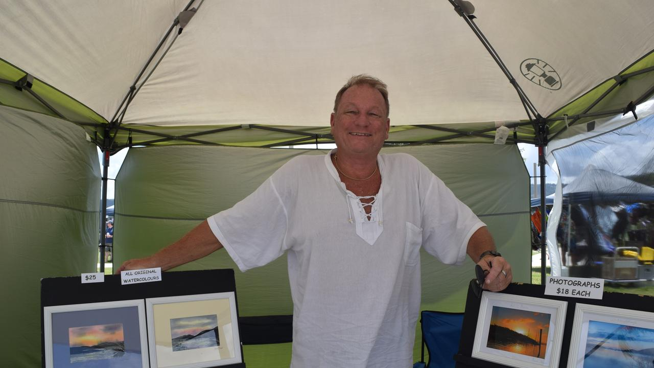 All smiles: Steve Fraser (pictured) and wife Jenni have been selling their photos and paintings at the Airlie markets for 20 years.