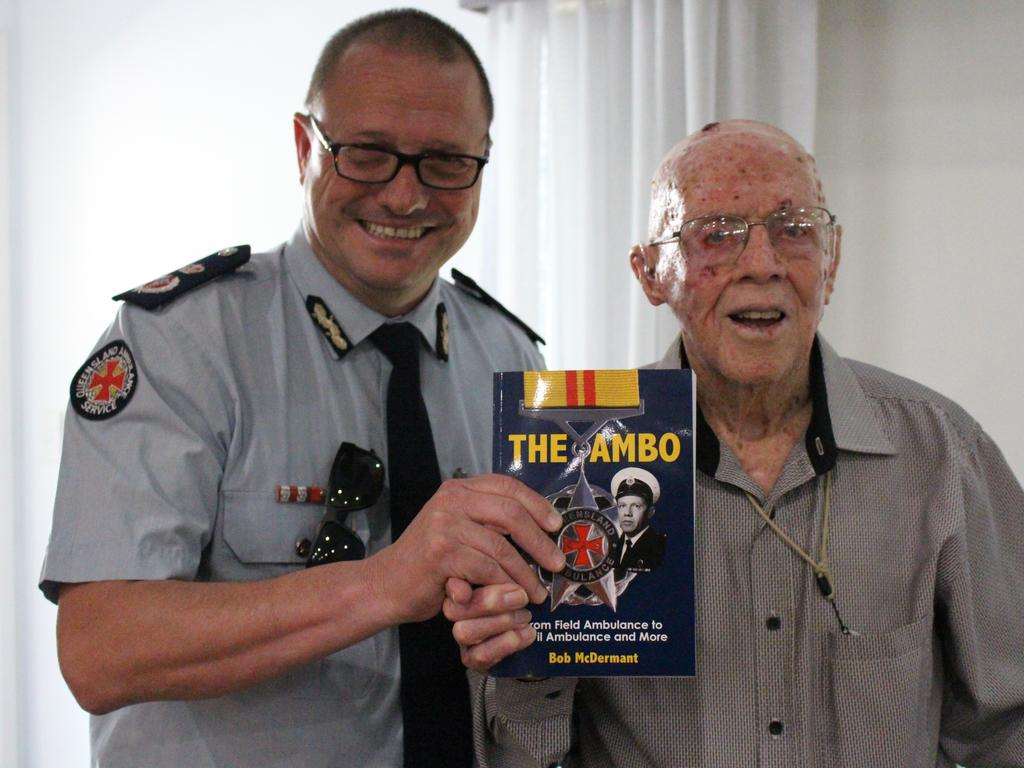 Commissioner of the Queensland Ambulance Service Russell Bowles with author Bob McDermant at the launch of his book.