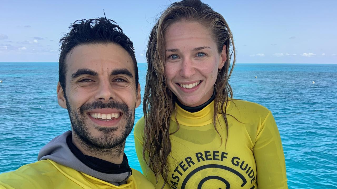REEF GUARDIANS: Just another day in the office for Pablo Cogollos and Kasey Barnes.