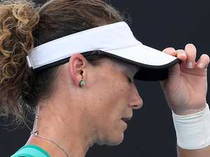 Sam Stosur stumbles out of Brisbane International
