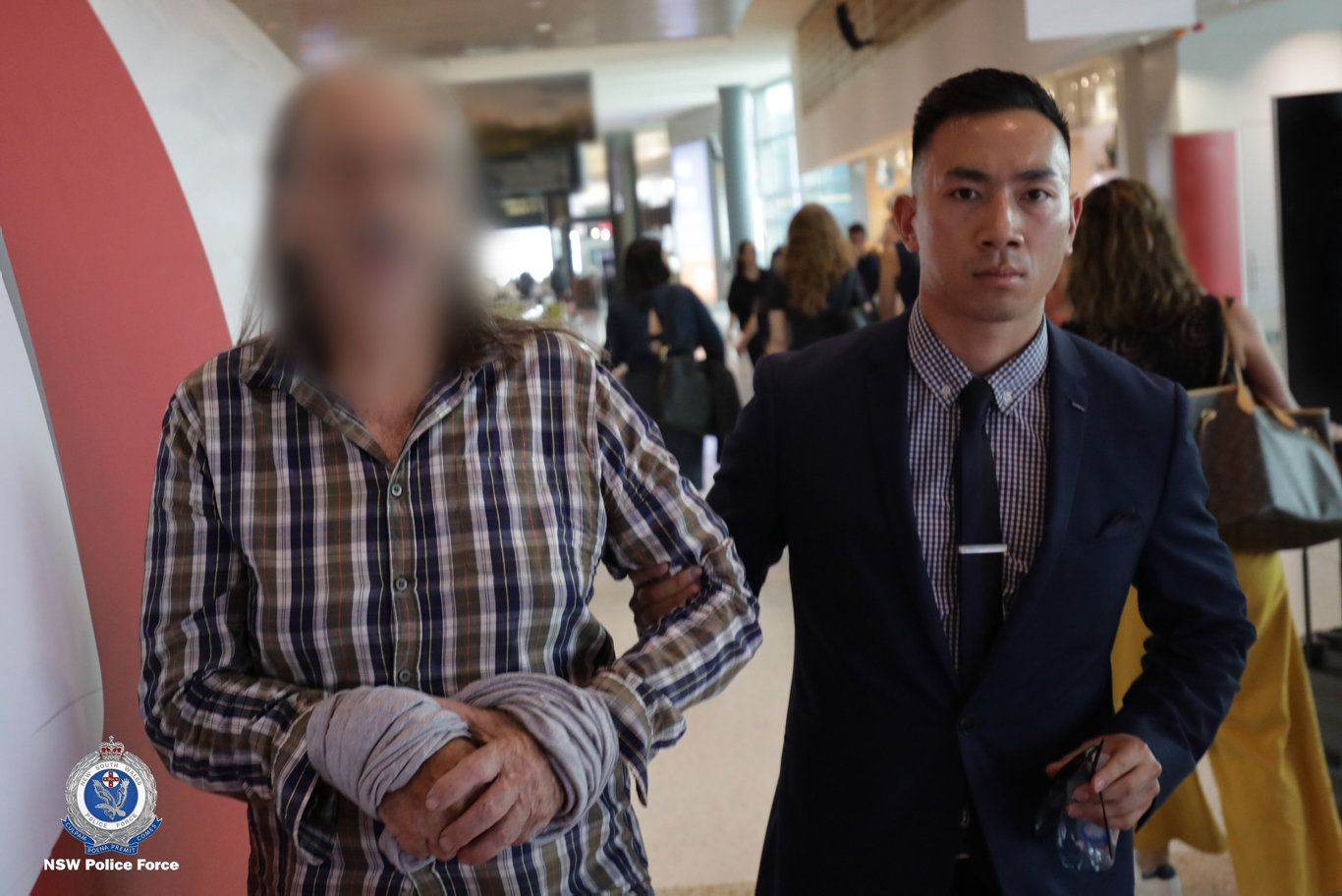 Trevor John Vernon is ushered into a Sydney court by a police officer.