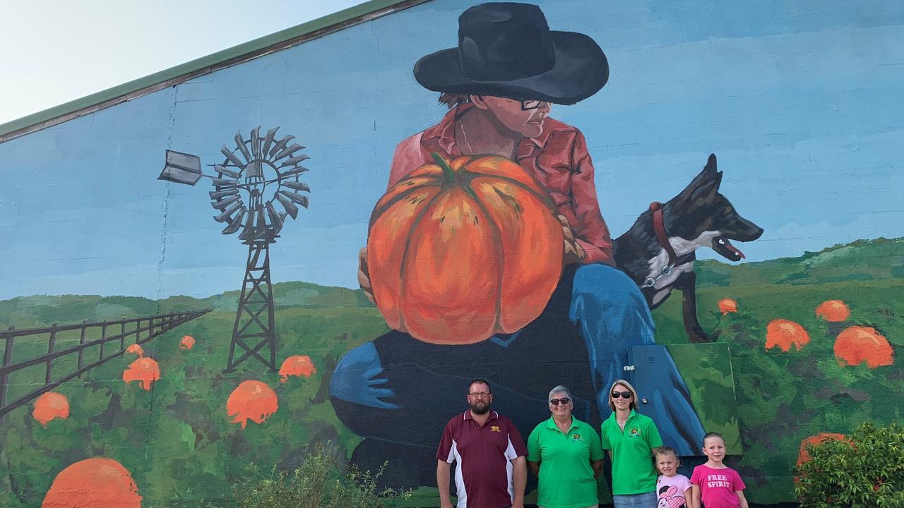 The Goomeri Pumpkin Festival team of Gary Schneider, Kim Boyter, Emma Schneider with Lara and Maddy Schneider in front of their new mural.