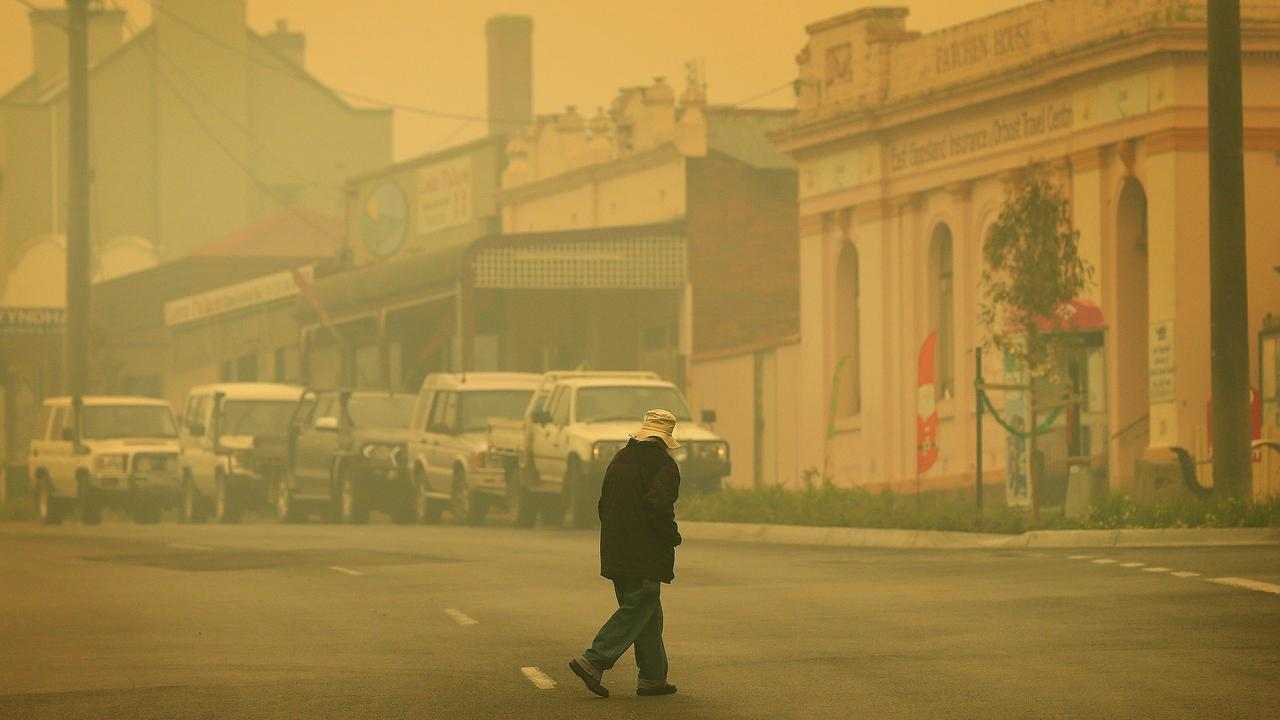 Smoke is heavy and visibility low down the main street of Orbost in fire ravaged East Gippsland. Picture: Mark Stewart