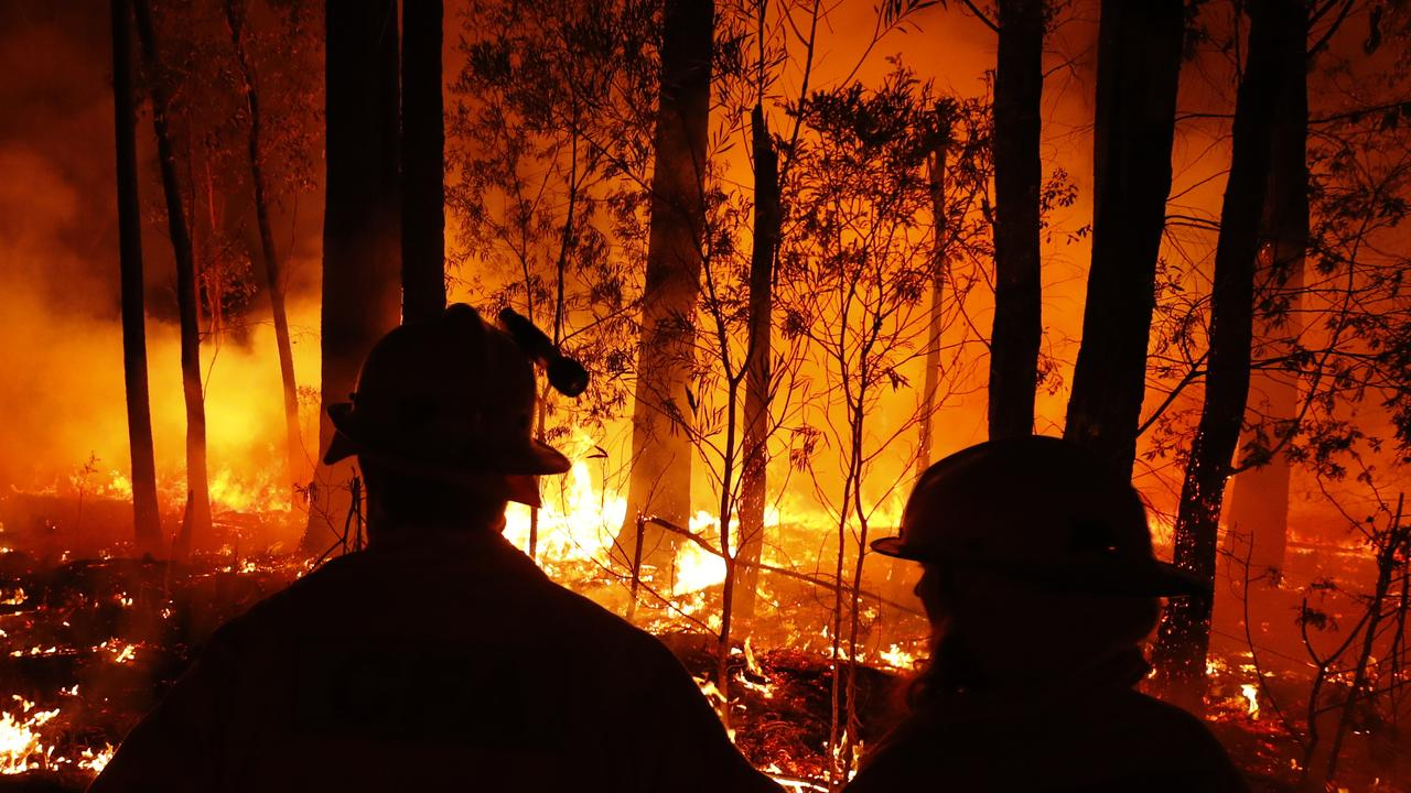 Crews monitor fires and begin back burns between the towns of Orbost and Lakes Entrance in East Gippsland during the current fire crisis. Picture: Darrian Traynor/Getty Images.