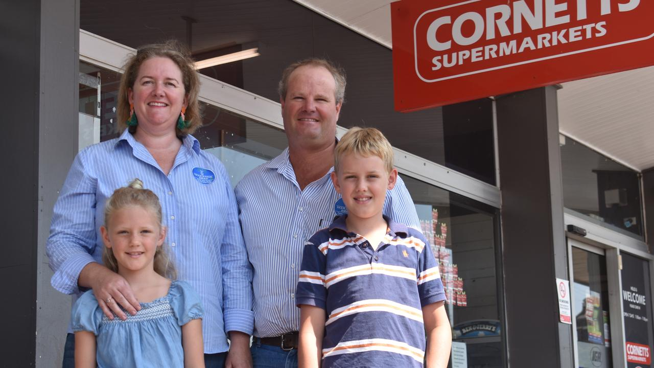 Rebecca and Craig Beissel with Maggie and Beau, from Maranoa Beef, which will hit the shelves of Roma IGA on Friday.