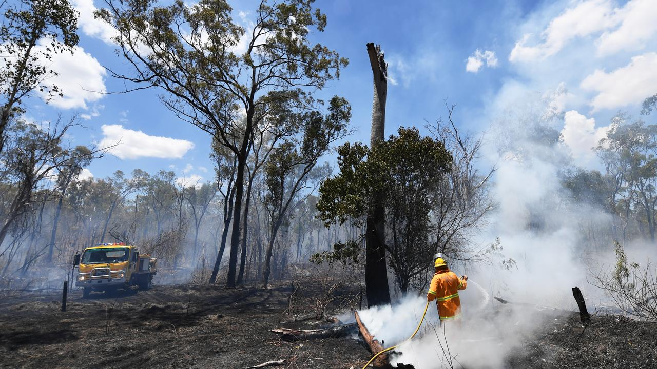 COMPENSATION GAP: Members of The Caves Rural Fire Brigade who are pictured here fighting a fire near Bakers Road Etna Creek may miss out on government compensation if they work for a large company unwilling to pay for leave.