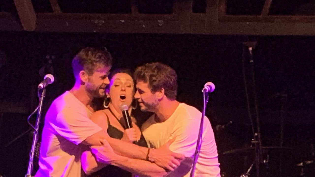 STAGE ANTICS: Chris Hemsworth, Celeste Barber and Liam Hemsworth on stage at the Beach Hotel in Byron Bay for the second day of the Make It Rain Fundraiser.