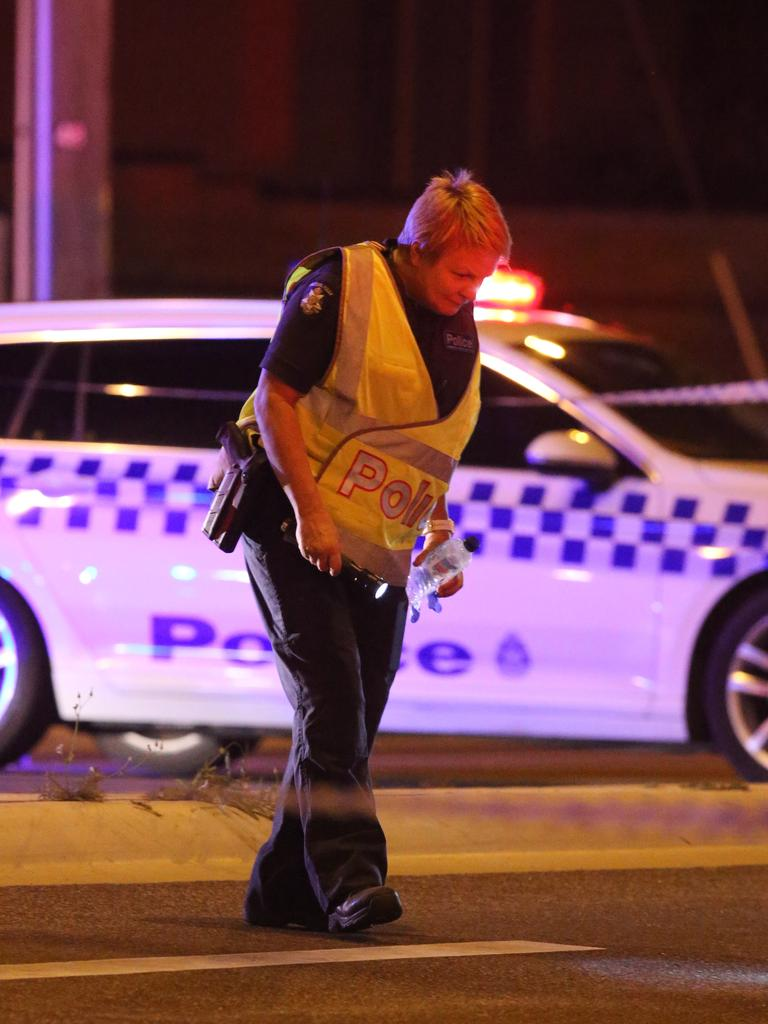 Police comb the scene for clues. Picture: Wayne Taylor