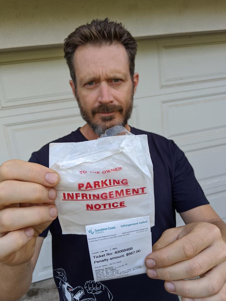 Lyndon Arnold displays his $667 fine for parking on the edge of Cotton Tree Park. Photo: Contributed