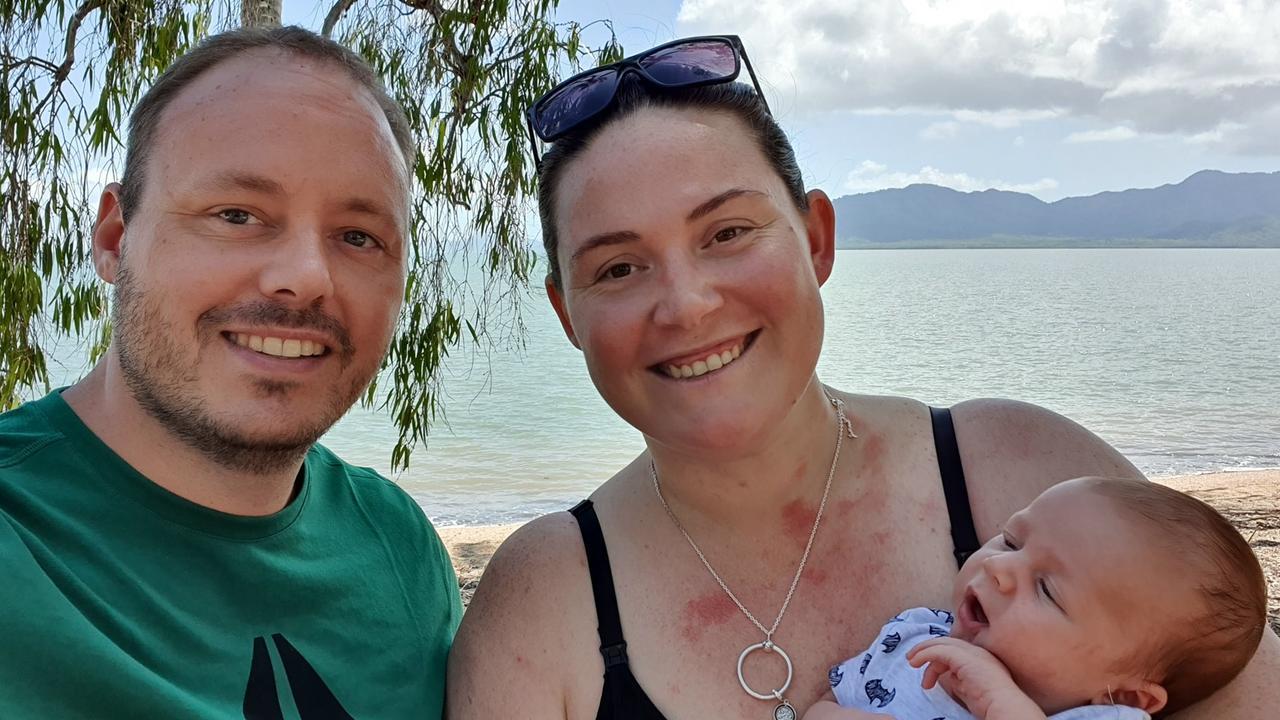 Ashlee and Adam Holstein with their newborn son, Mars.
