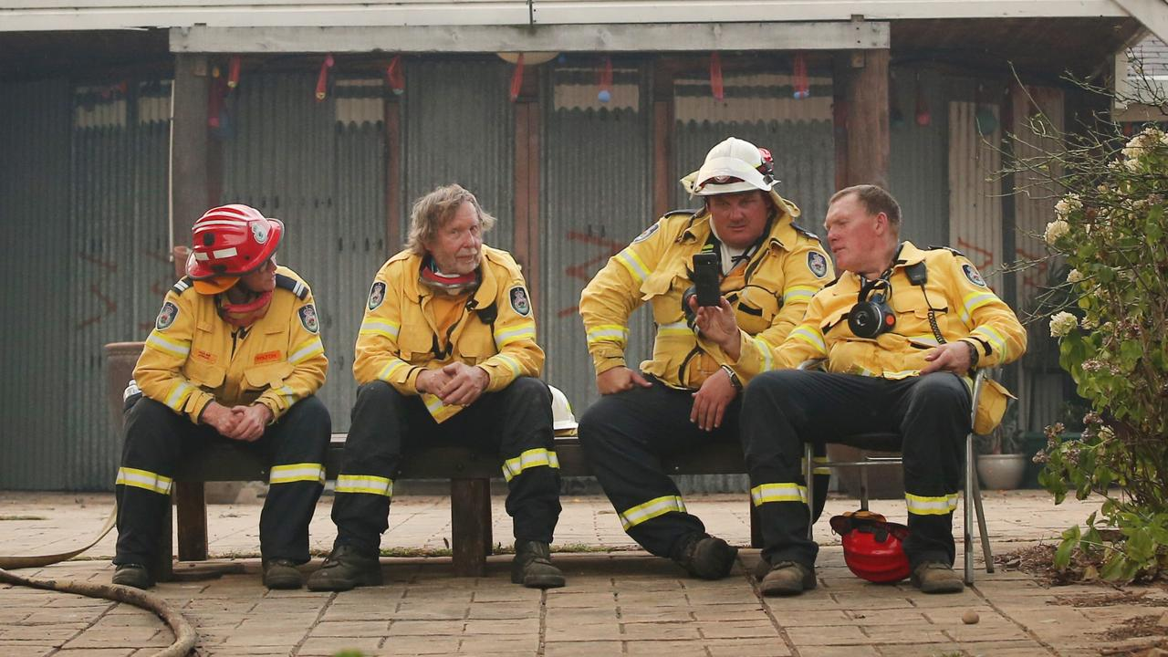 RFS fireys take a well earning break at the Sunnataram Buddhist retreat in Penrose. Picture: Richard Dobson