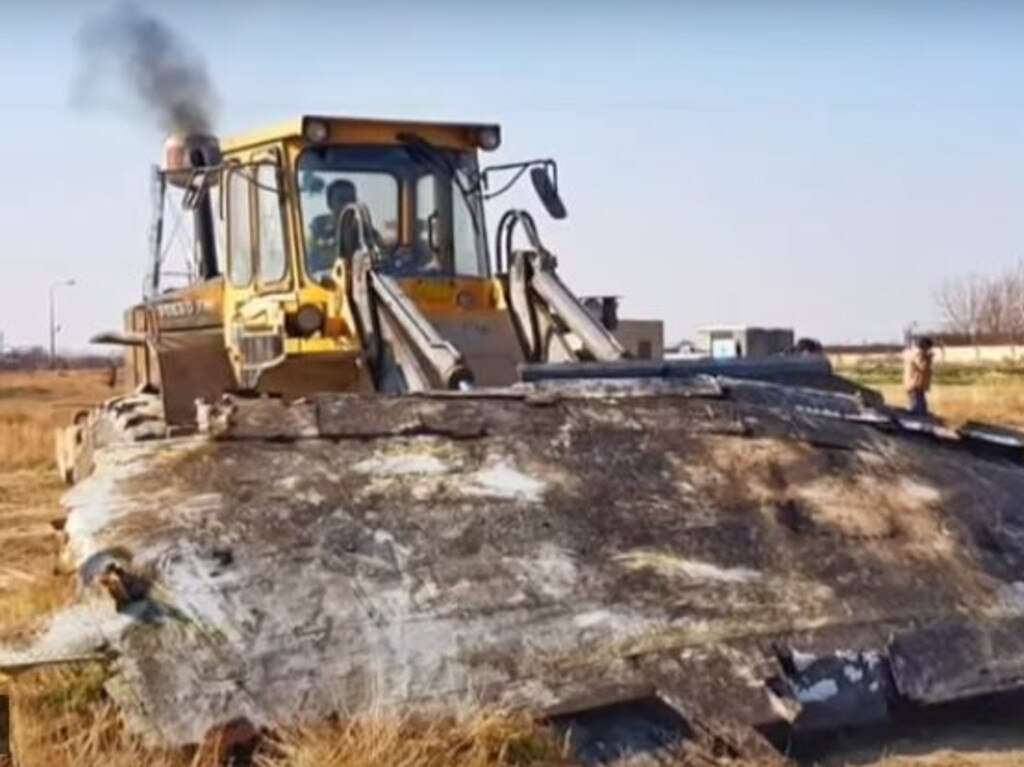 Bellingcat investigators have confirmed images showing bulldozers at the site of the Iranian plane crash. Picture: YouTube