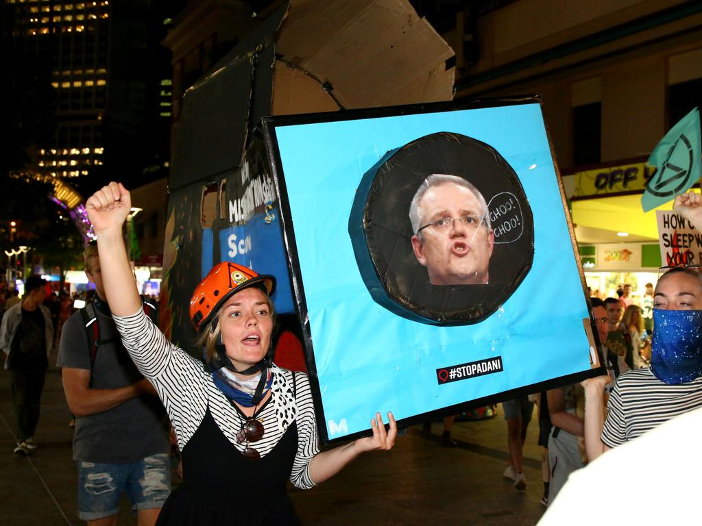 Protesters make their way through Brisbane CBD streets this evening. Picture: David Clark/AAP