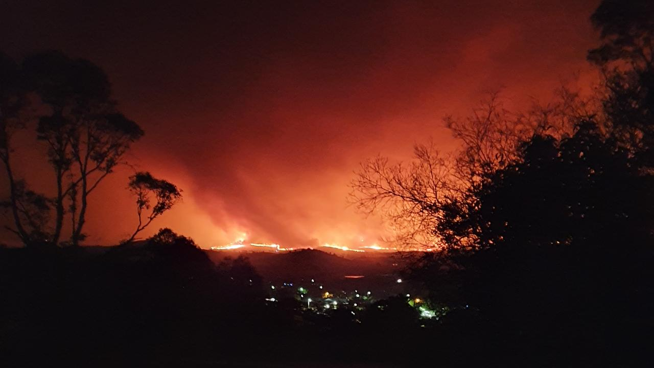 UP IN FLAMES: Corryong just before the fire jumped Mt Mittamatite in the early hours of New Year's Eve.