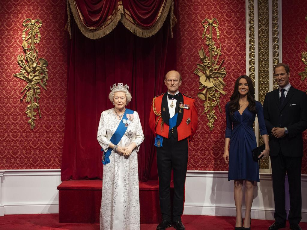 Madame Tussauds in London capitalised on the drama by moving the waxworks of Harry and Meghan away from those of the Queen, Prince Philip and Duke and Duchess of Cambidge. Picture: Victoria Jones/PA via AP.