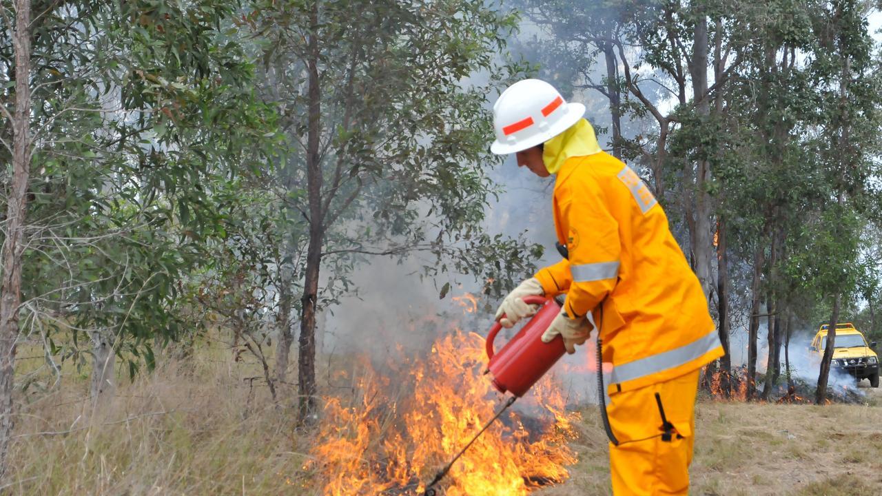 A rural fire fighter from Gunalda lights up bushland on Raspberry Lane Curra