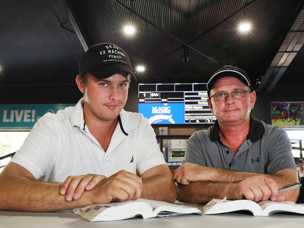 Trent Edmonds and Toby Edmonds check the sales guide at the Magic Millions complex at Bundall. Picture Glenn Hampson