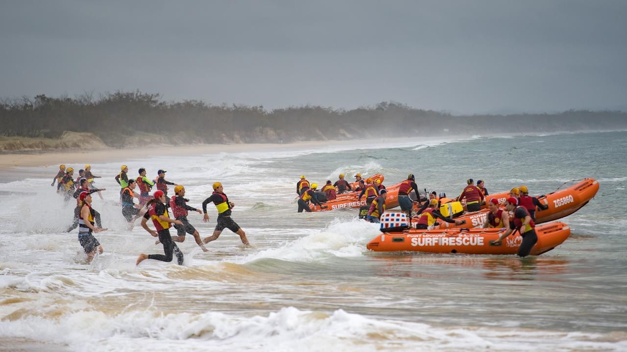 Surf lifesaving action at Rainbow Beach. Picture: HARVPIX