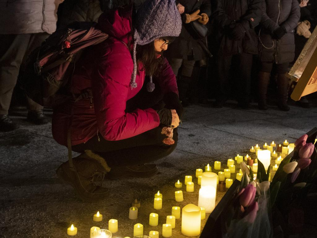 Canadians pay their respects at a candlelight vigil in Ontario to remember the victims of the Ukraine International Airlines plane crash, Ontario. Picture: Adrian Wyld/The Canadian Press via AP