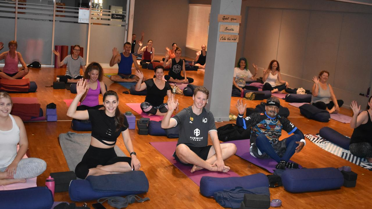YOGA: Participants at this morning's yoga class. All money raised from the class will be donated to the Australian Bushfire Appeal.