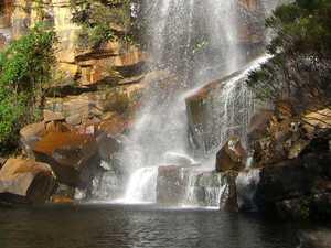 Woman stuck at bottom of waterfall, calls 000