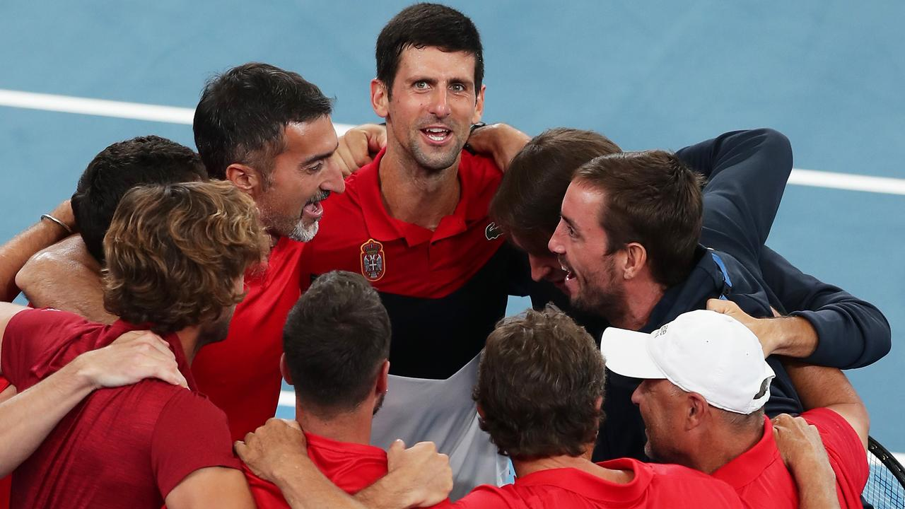 Novak Djokovic celebrates his semi-final win with the Serbian team. Picture: Getty Images