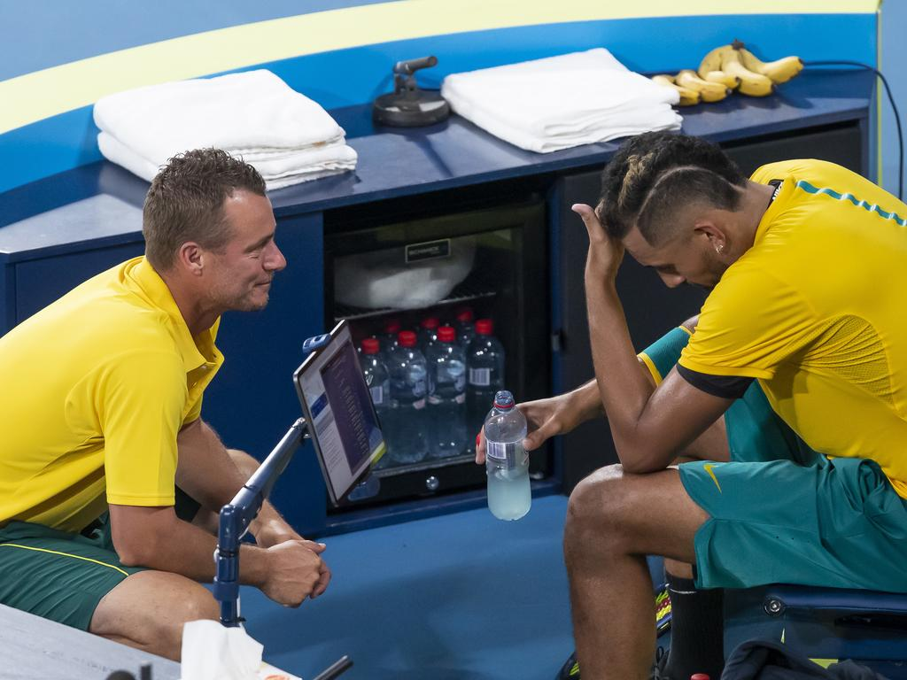 Nick Kyrgios of Australia with coach Lleyton Hewitt