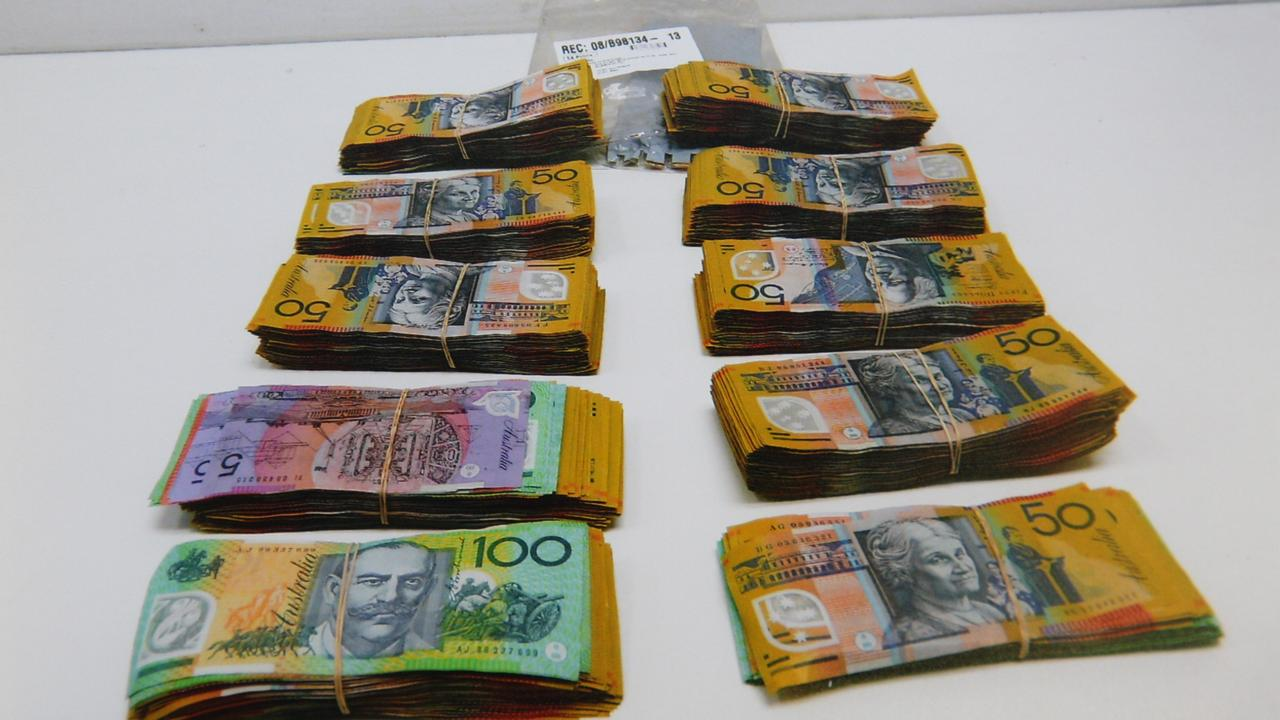 Stacks of cash found in Logan male's car on Warrego Hwy.