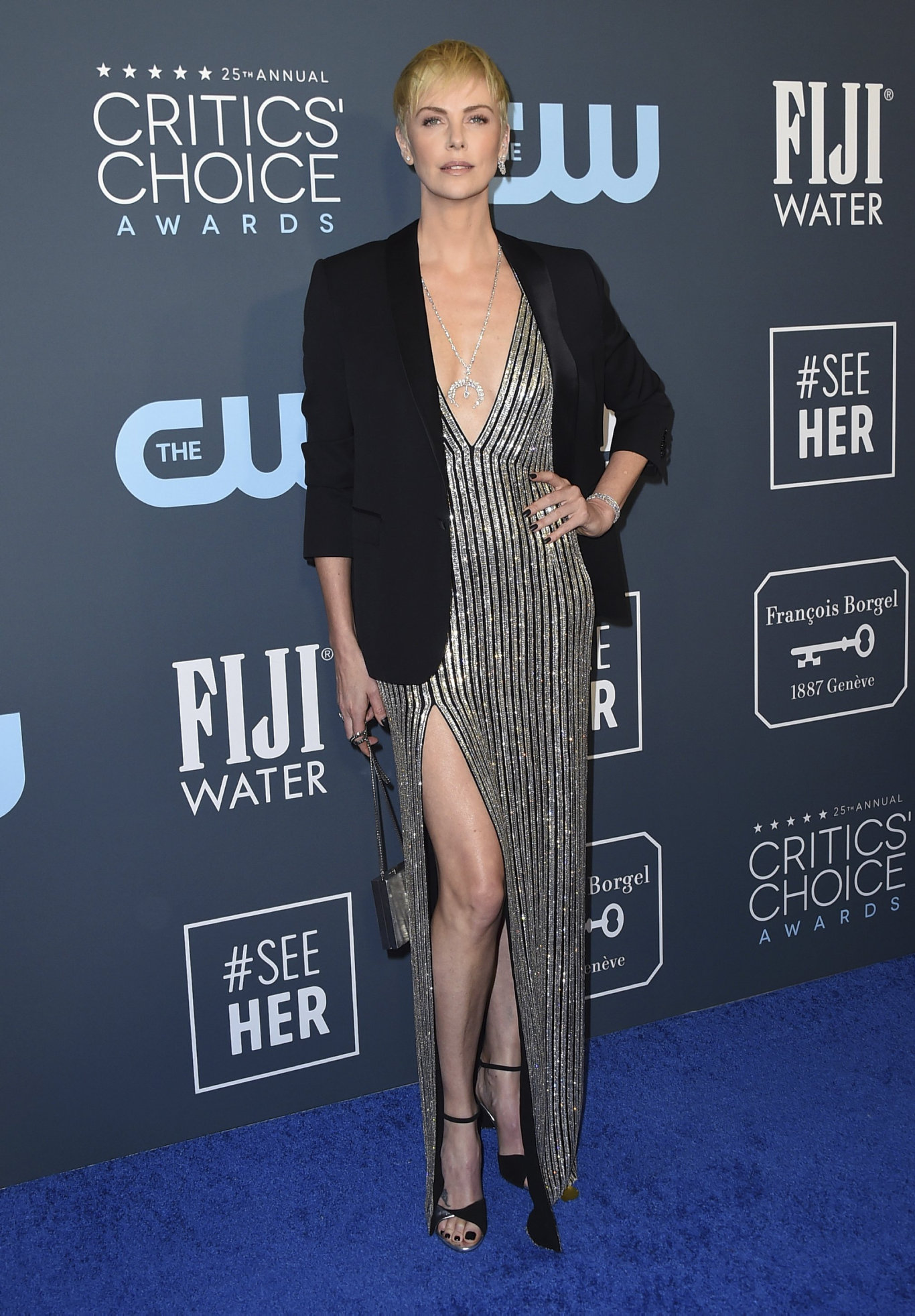 Charlize Theron arrives at the 25th annual Critics' Choice Awards at the Barker Hangar in Santa Monica, Calif.