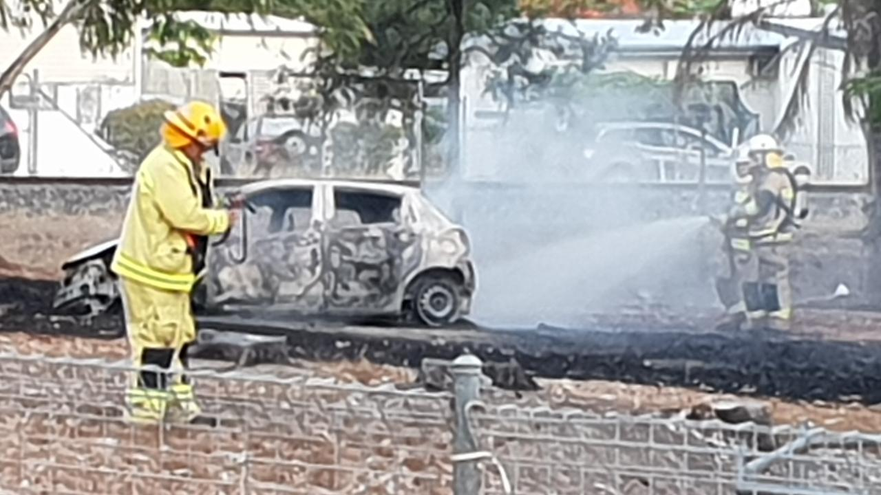STOLEN VEHICLE: Firefighters work to extinguish the torched Toyota Yaris, set ablaze in Park Avenue on Saturday.