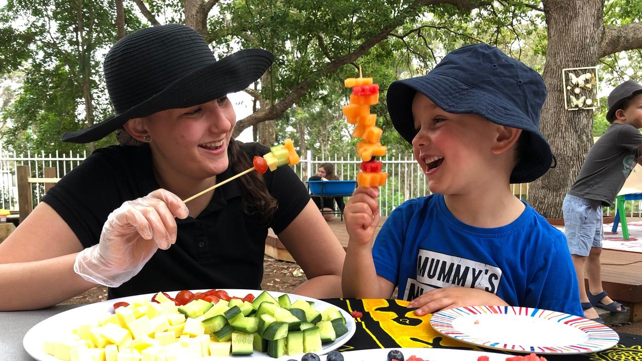 School holidays TAFE NSW student Layla Stamatis with Marcus Bolton finding fun in food.