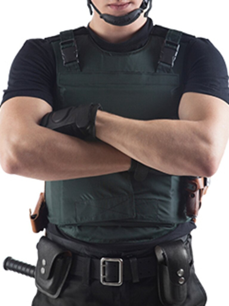A man wearing an ultra light ballistic vest.