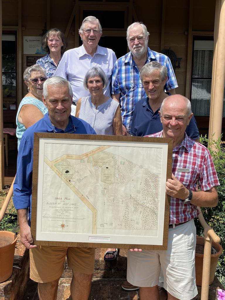 HISTORY: Members of the Buder Historical Society watch on as Keith Neuendorf hands over the historical golf course plans to Buderim Historical Society president David Wood. Photo: Abbey Cannan