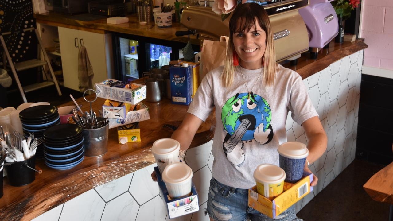 Boy Espresso owner Carly Urquhart uses old UHT containers for takeaway cup trays. Photo: Sam Reynolds
