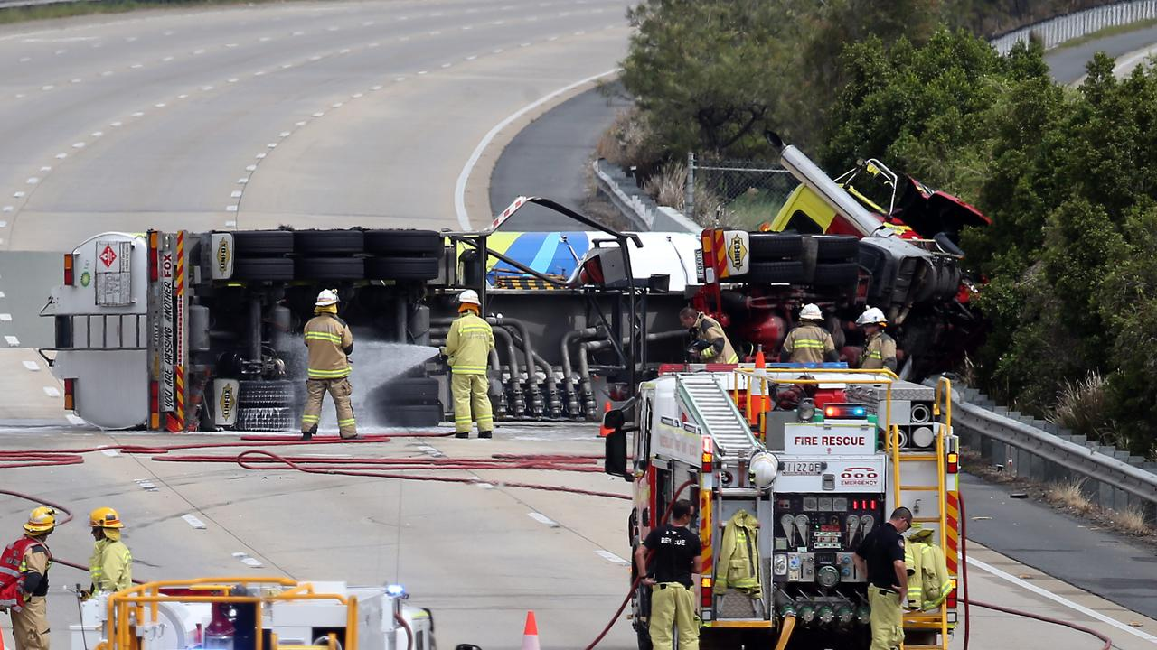 A petrol tanker overturned on the M1 at Helensvale on Saturday, closing the motorway for 16 hours. Picture: AAP Image/Richard Gosling