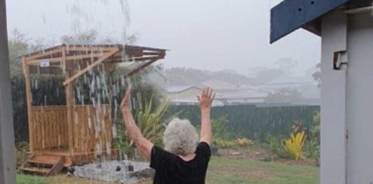 RAIN DANCE: Local woman, Barb Chapman welcomed the rain with open arms.