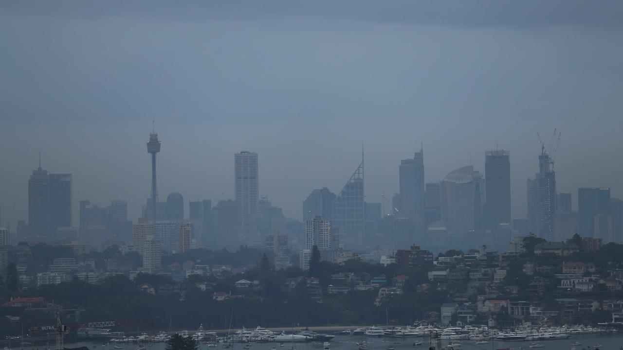 A week of rain was signalled by grey weather in Sydney on Sunday. Picture: John Grainger