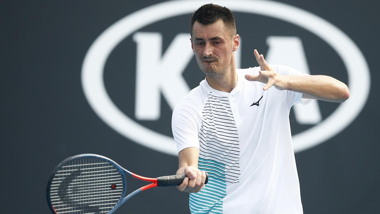 Bernard Tomic plays a forehand in his match against Denis Kudla.
