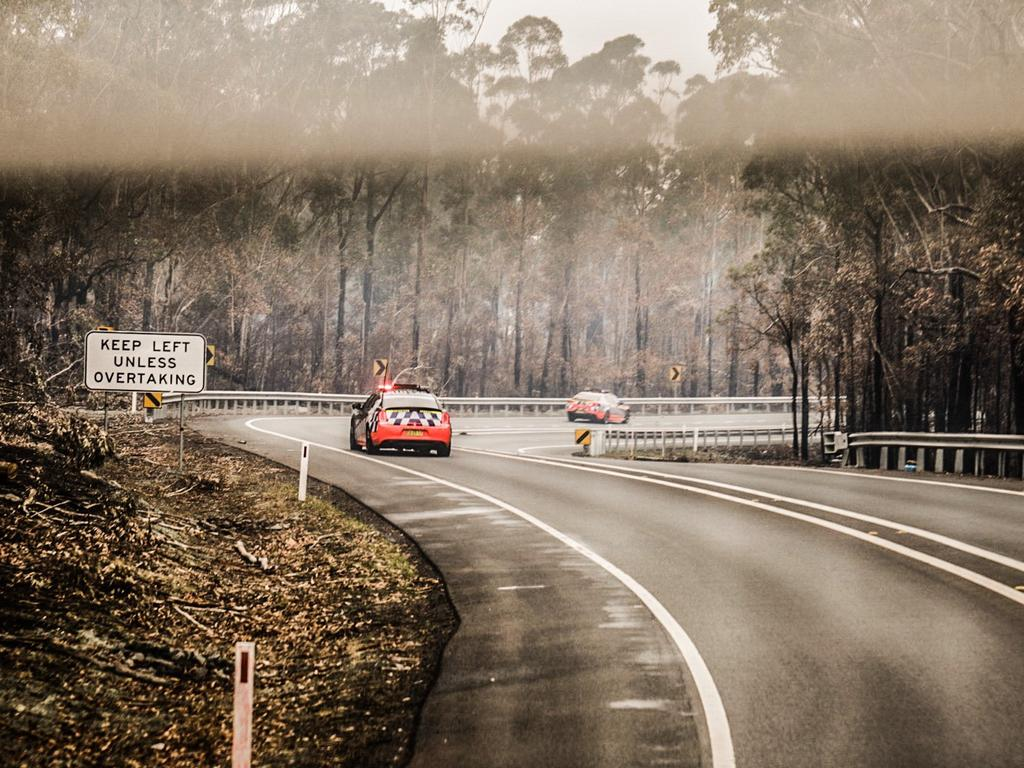 A blackened landscape stretched the length of the Sunny Coast Love Run's final seven hours into Cobargo.