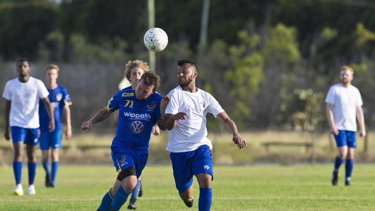 USQ FC's Ashley Freier (left) battles for possession with Rockville's Diego Farias.
